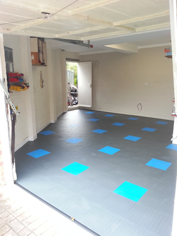 transform a concrete garage floor with mototile interlocking tiles. Black Bedroom Furniture Sets. Home Design Ideas